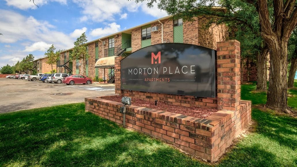 Signage and building view of Morton Place Apartments in Amarillo, TX.
